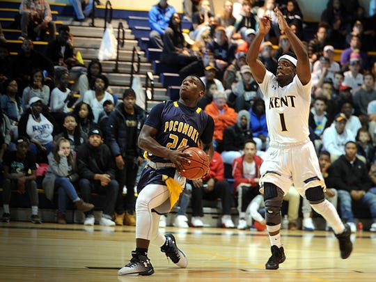 Pocomoke's Tyree Thornton escapes Kent's Marcquan Greene in the 1A East Region Final on Saturday, March 4, 2017 in Worton.