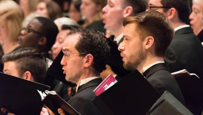 Assistant conductors Austin Thorpe and Phil Biedenbender singing during the Chorus's Fall Concert, November 19, 2017