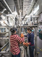 Scientists at work in the Mag Lab's Electron Magnetic Resonance Facility.