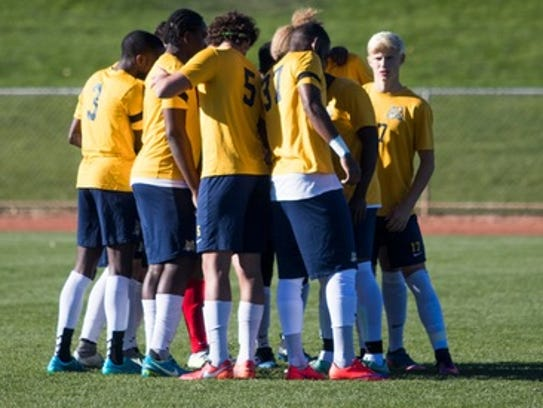 Schoolcraft College players huddle up before the Nov.