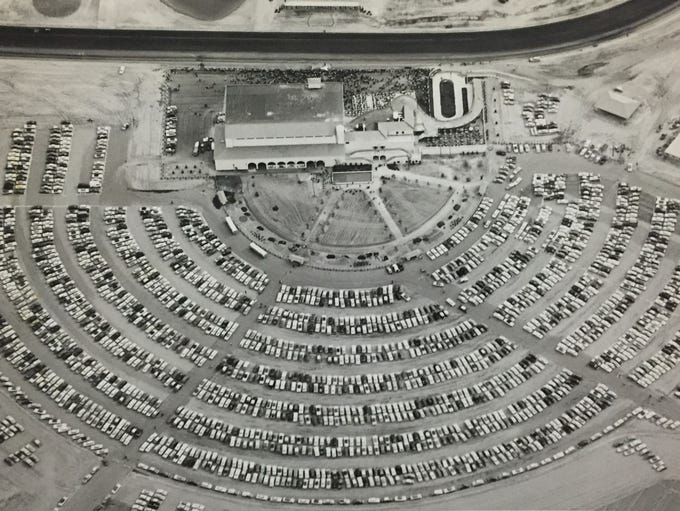 An aerial view of the track and packed parking lot