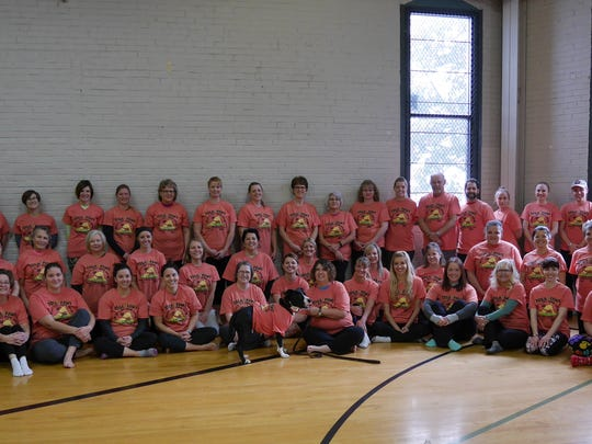 Yoga 4 Paws participants gather for a group photo Dec. 9 in Stevens Point.
