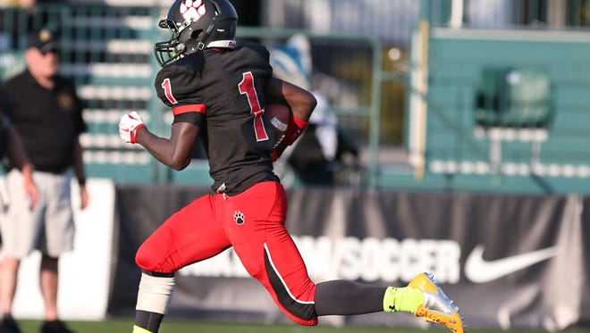 Wilson's Isaiah Benjamin races to the end zone for a score on a fourth and one play during their game at Sahlen's Stadium in Rochester Friday, Sept. 25, 2015.