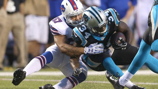 Bills linebacker Ty Powell (57), makes the tackle on