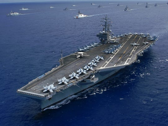 This Nimitz-class carrier prepares to join in maritime