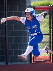 Oak Creek's Tori Golden celebrates her solo home run