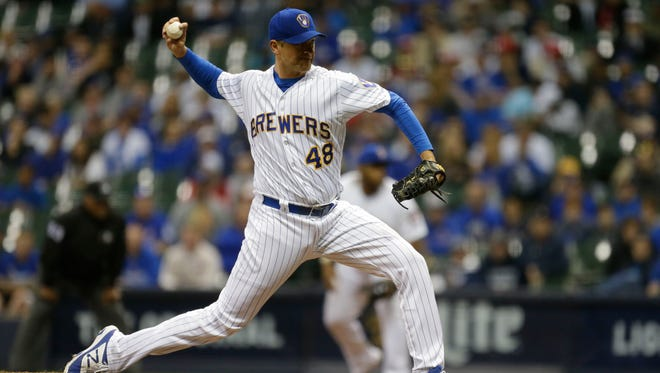 Brewers reliever Jared Hughes pitches during the 10th inning of Milwaukee Brewers game against the Chicago Cubs on Friday, April 7, 2017 at Miller Park.