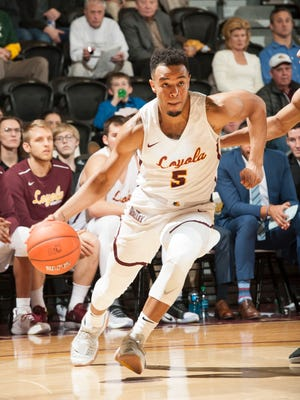 Marques Townes handles the ball for Loyola (Chicago). The former St. Joseph (Metuchen) standout is thriving there.