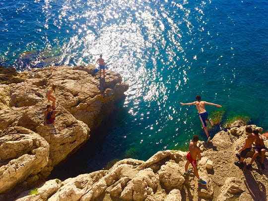 "UNC Asheville Study Abroad student Michael Albinger took this photo, titled ""Nice Cliff Jump,"" in France."