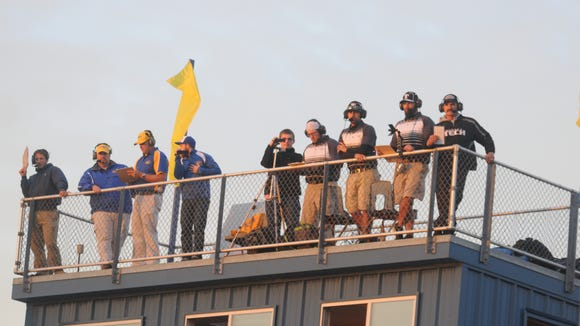 The offensive and defensive coordinators of the Sussex Tech and Sussex Central football teams watch the game from on top of the press box Monday night in Georgetown.