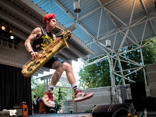 Too Many Zooz performs at the Johnson Controls World