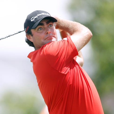 Steven Bowditch hits his tee shot on the 18th hole.