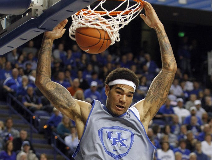 The White Team's Willie Cauley-Stein dunks during the second half of Kentucky's NCAA college basketball's scrimmage, Tuesday, Oct. 29, 2013, in Lexington, Ky. The Blue team won 99-71. (AP Photo/James Crisp)