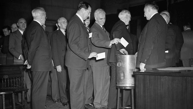 In this Dec. 16, 1940 file photo, New York State electoral college members cast votes at the state capital in Albany, N.Y. Most people who voted early or are heading to the polls on Nov. 8, 2016 think they will be voting for Democrat Hillary Clinton, Republican Donald Trump or their chosen third-party candidate. But they won't be. They'll be voting for their state's electors, who will in turn cast votes for the presidential candidate who wins the most votes in their state.