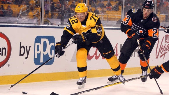 Brandon Manning, right, will sit the next two games for his hit on Jake Guentzel.