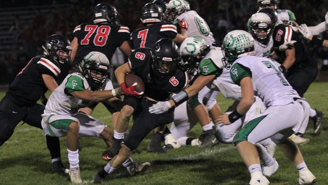 Pleasant's Matt Chase gains some tough yards against Clear Fork last week. If Marion Harding can upset the Colts and Pleasant beats Ontario, the Spartans would share the Mid Ohio Athletic Conference title with the Colts.