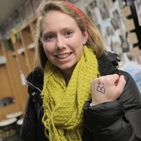 """Madeline Buckley shows off the """"B+"""" she writes on her left hand every day to remind her that she is """"in the service of others."""""""