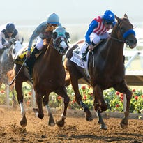 In a photo provided by Benoit Photo, California Chrome and jockey Victor Espinoza, left, hold off Dortmund, with Gary Stevens aboard, to win the Grade II, $200,000 San Diego Handicap on Saturday at Del Mar Thoroughbred Club.