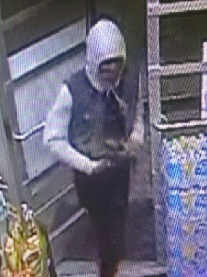 Surveillance video image captured during a Milton-area gas station robbery Friday, Oct. 21.
