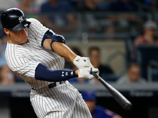 New York Yankees' Aaron Judge hits a home run against the New York Mets during the sixth inning of a baseball game Monday, Aug. 14, 2017, at Yankee Stadium in New York. (AP Photo/Rich Schultz)