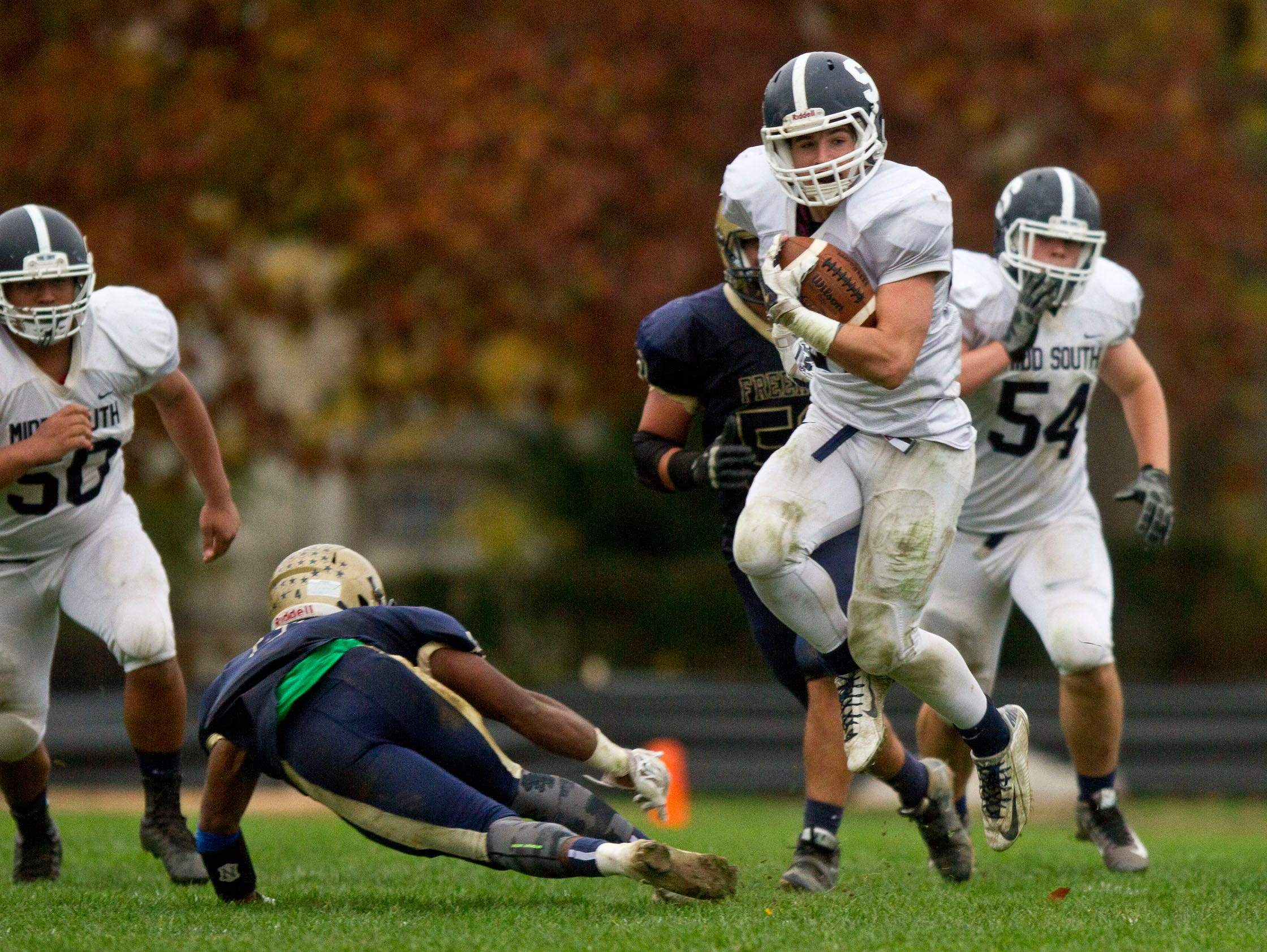 Middletown South's Cole Rogers gains yardage on the ground. Middletown South at Freehold football. Freehold, NJ Saturday, November 7, 2015 @dhoodhood