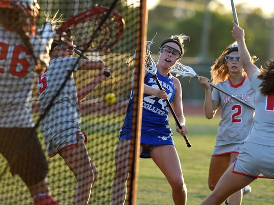 Barron Collier's Jo Imbriani (24) shoots Friday, April 21, 2017, during her team's high school lacrosse game against Vero Beach at Vero Beach High School.