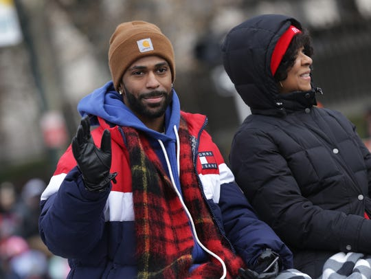 Co-Grand Marshall Big Sean salutes the crowd during