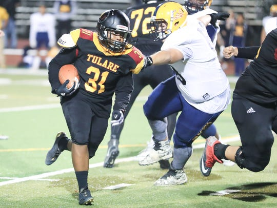 Tulare Union's Donavan Smith is battling for playing
