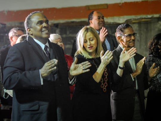 Artist Barry Scott, left, Mayor Megan Barry and civil