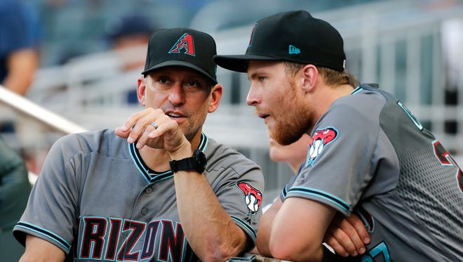 Arizona Diamondbacks manager Torey Lovullo (17), left, talks with Arizona Diamondbacks second baseman Brandon Drury (27) before the first inning of a baseball game against the Atlanta Braves Friday, July 14, 2017, in Atlanta.