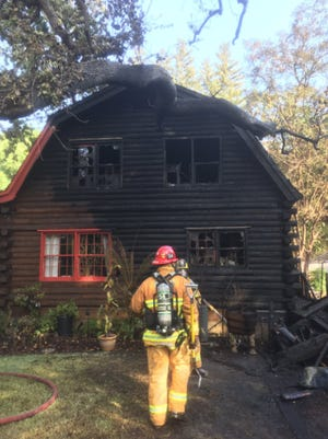 Crews with the Ventura County Fire Department battled a house fire that spread to a neighboring home Monday in Thousand Oaks.