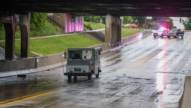 A U.S. Postal Service truck sits stranded on Grand Ave. in Ames after a flash flood on Thursday, June 14, 2018.