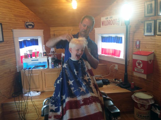 Harold Vanderlan, 6, is one of John York's regulars at John's Barber Shop inside the old airplane filling station on Clinton Highway, May, 2017.