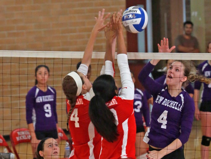 New Rochelle's Violet Thompson (4) returns the ball against North Rockland at North Rockland High School in Thiells on Sept. 2, 2014.  New Rochelle won the first two sets.