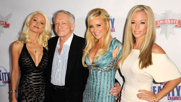 Hugh Hefner, second from left, with his former girlfriends,
