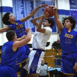 Boys basketball: Reed holds off McQueen