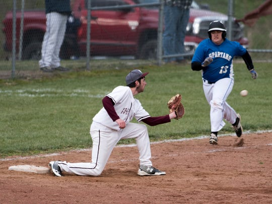 Southern Fulton's Kyle Smith catches a ball on  first base and tags out Justin Welsh of McConnellsburg during a boys baseball game on Friday, April 8, 2016 in Warfordsburg, Pa. Southern Fulton defeated McConnellsburg 4-0.
