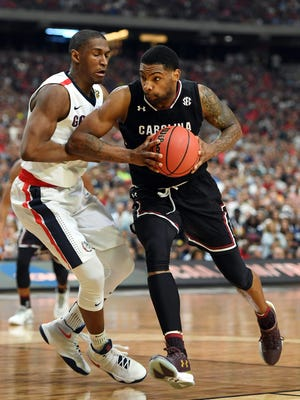 South Carolina Gamecocks guard Sindarius Thornwell (0) drives against Gonzaga Bulldogs guard Jordan Mathews.