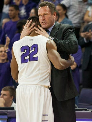 Senior Royce Woolridge hugs coach Dan Majerle at the end of their final game of the regular season on Saturday, March 7, 2015, at the GCU Arena in Phoenix.