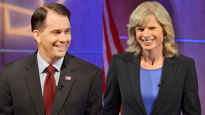 Gov. Scott Walker debates Democratic challenger Mary Burke at Mayo Clinic Health Systems auditorium in Eau Claire.