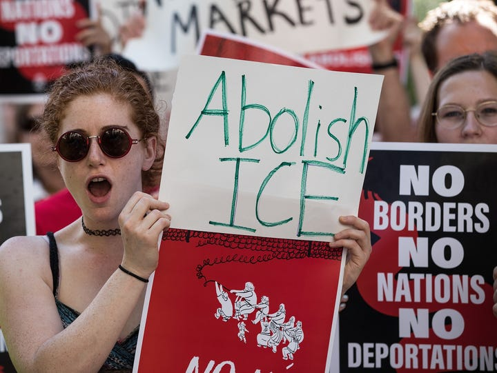 Activists march and rally against Immigration and Customs