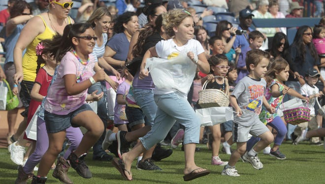 The race is on to collect about 3,500 pounds of candy during the Dolly Sanchez Memorial Easter Egg Hunt in 2012.