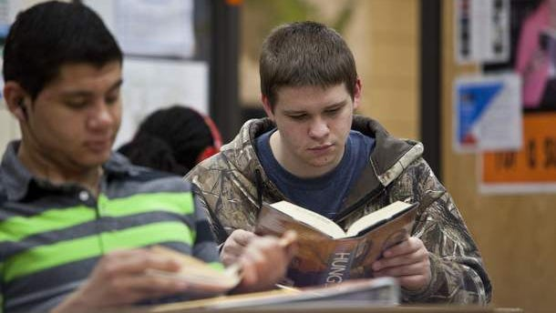 Hunter Strahl is a reading success story. He received extra help in fourth and fifth grades to overcome early struggles. Now 17, he's in a Valley High School young adult literature class, where he continues to improve his reading skills. /