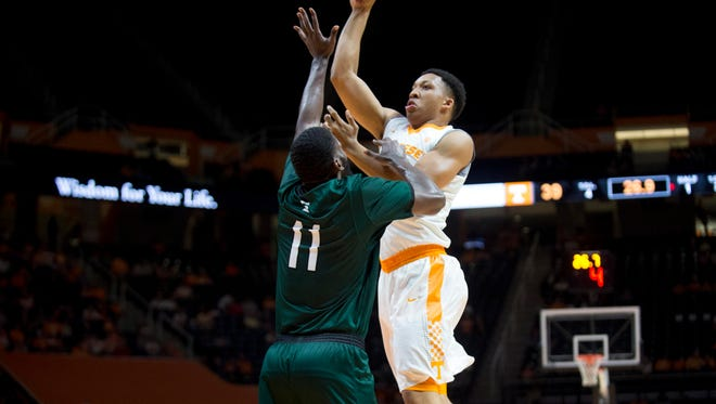 Tennessee's Grant Williams attempt to score over Slippery Rock's Amir Maddred at Thompson-Boling Arena on Thursday, November 2, 2016.