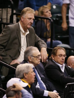 Pacers owner Herb Simon (right), shown with team president Larry Bird (standing) and consultant Donnie Walsh, said he'd be OK trading for Lance Stephenson but Bird handles all basketball decisions.