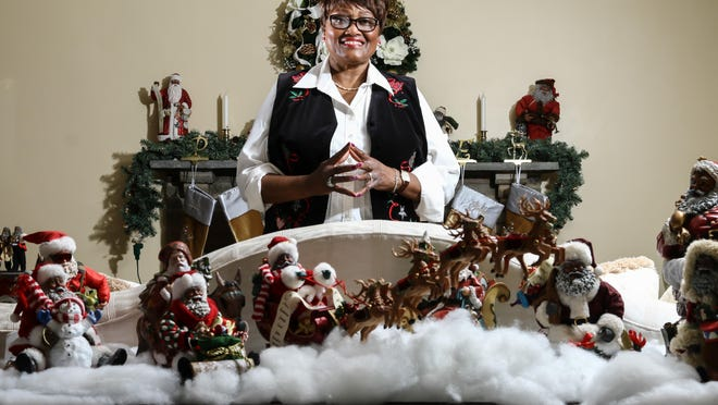 Collector Anita Young began collecting her black Santas in 1987. This is a teeny portion of the living room.