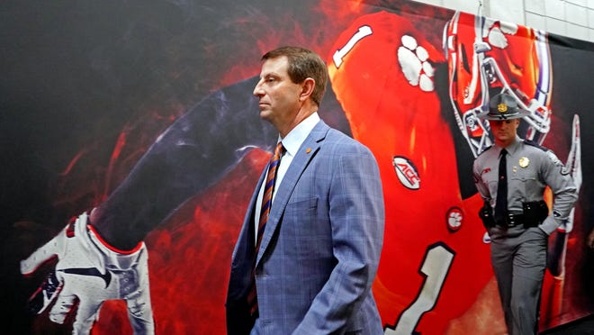 Clemson coach Dabo Swinney walks into the stadium before the College Football Playoff national championship game against the LSU Tigers in January.