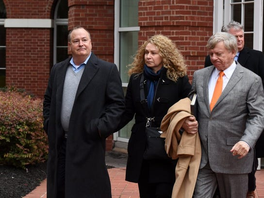 Former Pilot Flying J President Mark Hazelwood, left, leaves federal court after being arraigned on charges including conspiracy to commit wire fraud and mail fraud as well as witness tampering. Seven other Pilot employees were also named in the 14-count indictment.