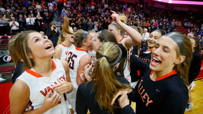 Valley celebrates a win in the 5A state semifinal game against Iowa City West March 3, 2017.