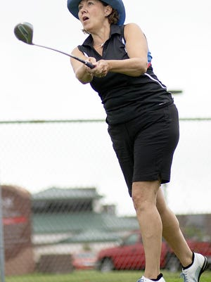 Lorie Larsen eyes her drive from the third tee at Bunker Links during the opening round of the Galesburg Women's All-City golf tournament on Tuesday.